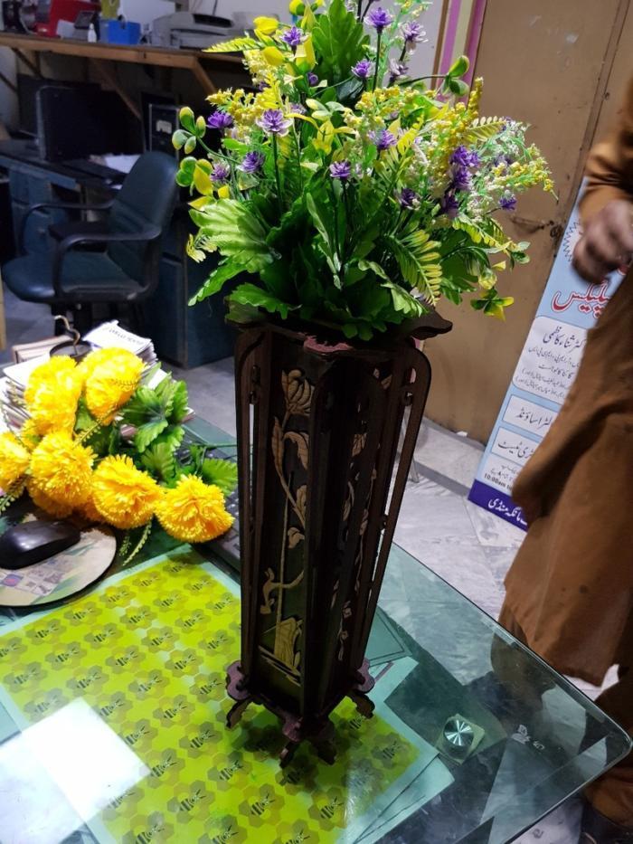 Laser Cut Flower Stand Free CDR Vectors Art