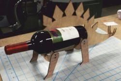 Cnc Laser Cut Stegosaurus Shaped Wine Bottle Holder Free CDR Vectors Art