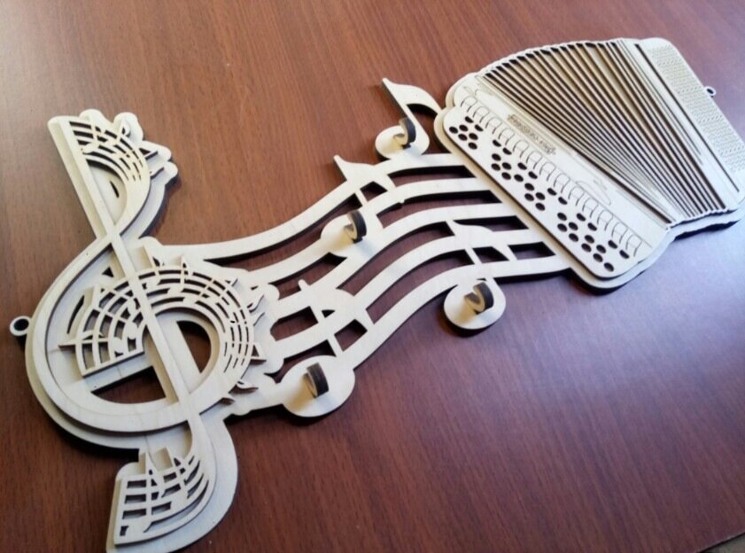 Key Hangs Shaped Like Music Notes Free CDR Vectors Art