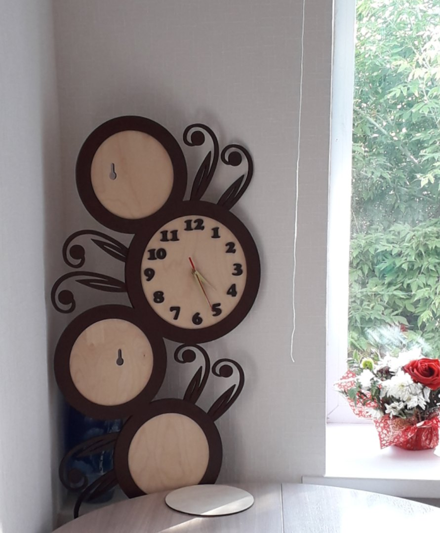Laser Cut Clock With Family Photo Frames Free CDR Vectors Art