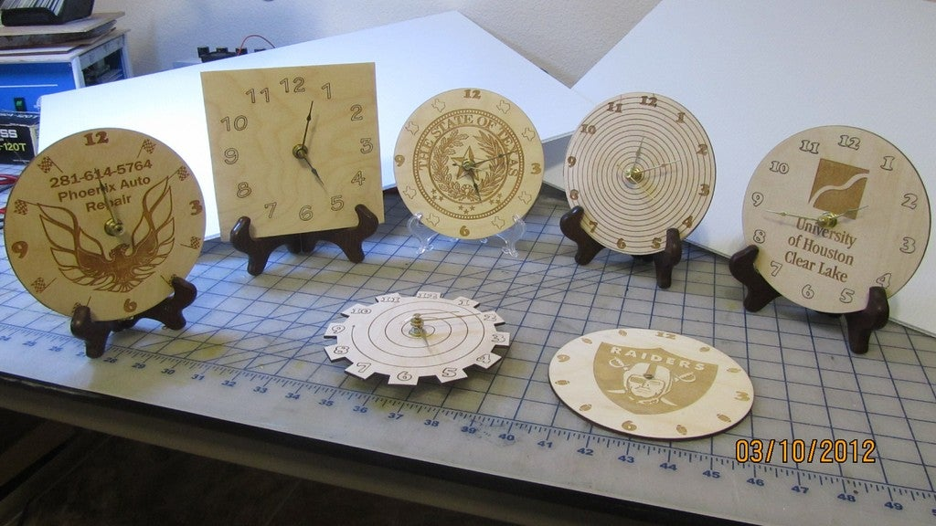 Laser Cut Engraved Wooden Clocks With Logos Free CDR Vectors Art